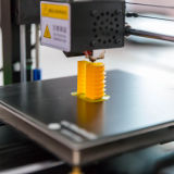 image of a 3d printer printing a plastic part