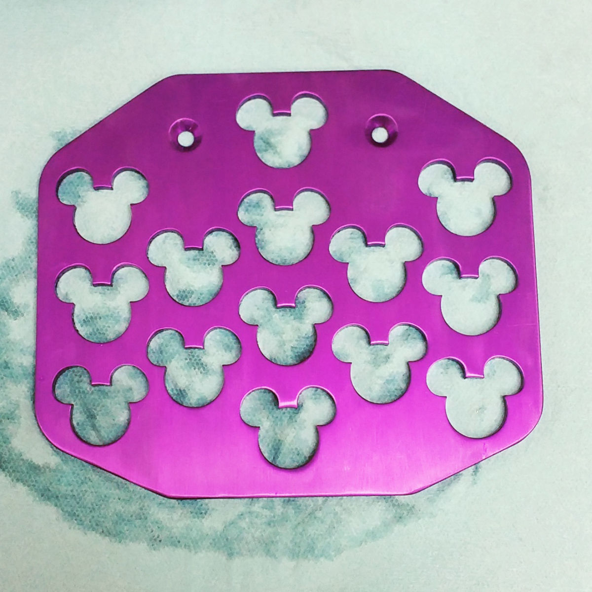wheelchair footplate with mickey mouse cut into it